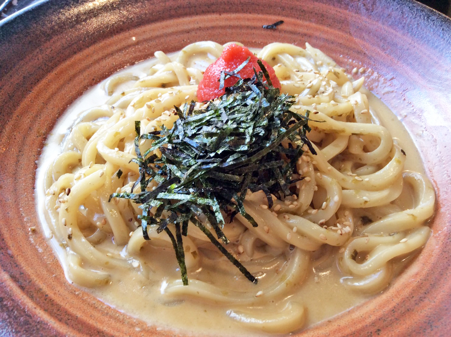Japanese Cream sauce Udon with seaweed flakes and Mentaiko